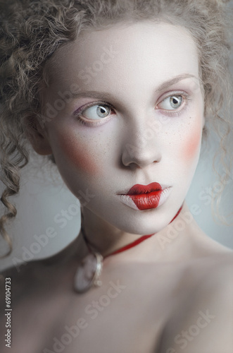 Portrait of beautiful pale woman in old fashioned style