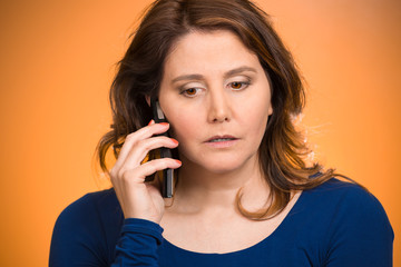 Sad stressed hopeless woman talking on mobile phone