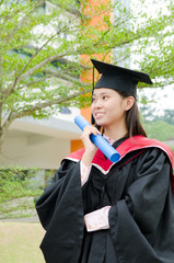 asian female student in graduate gown
