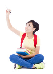 beautiful student asian girl sitting on floor and drawing