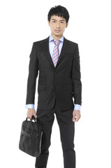 successful young business man carrying a suitcase