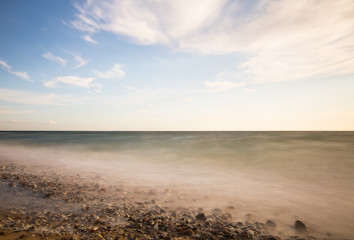 Summer scene, ocean photographed with long exposure daytime