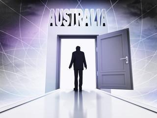 person going to visit Australia behind magic doorway background