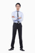 confident businessman with his hands in pockets