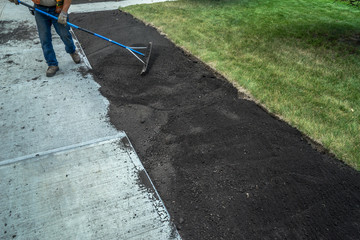 Application of Top soil at  new sidewalk