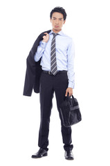 Full body young business man carrying a suitcase
