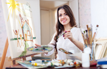 woman paints  on canvas