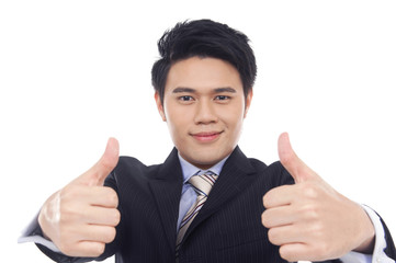 Smiling young business man showing thumbs up sign