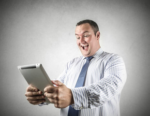 excited businessman by reading good news