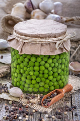 canned fresh domestic peas in a jar on an old rustic table