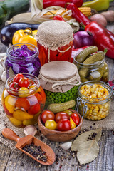 Several kinds of healthy domestic canned vegetables in jars