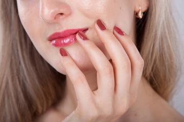 beautiful manicure and lips close up