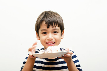 Little boy showing rice happy face