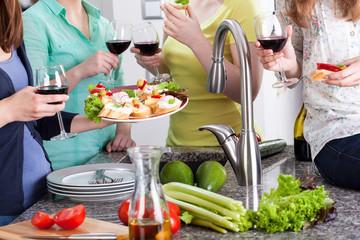Girls spending time in kitchen