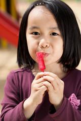 Asian girl with lollipop