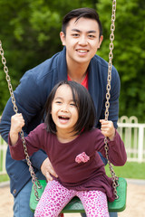 Asian family on a swing