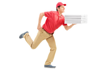 Profile shot of a pizza delivery guy running