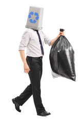 Man with a recycle bin over his head