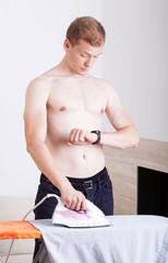 Businessman ironing his shirt