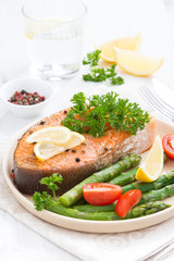 baked salmon with asparagus, parsley and lemon, vertical