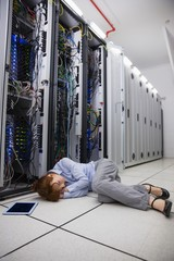 Exhausted technician sleeping on the floor