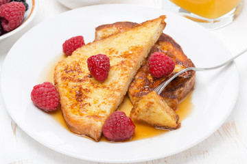 French toast with raspberries and maple syrup, top view