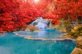 Wonderful Waterfall and red leaf in Deep forest at Erawan waterf
