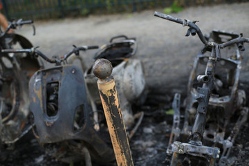 Burnt bikes and scooter after a fire, accident