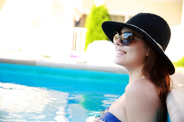 Portrait of a happy woman standing in the swimming pool