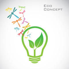 Vector bulb and dragonfly and leaves. eco concept