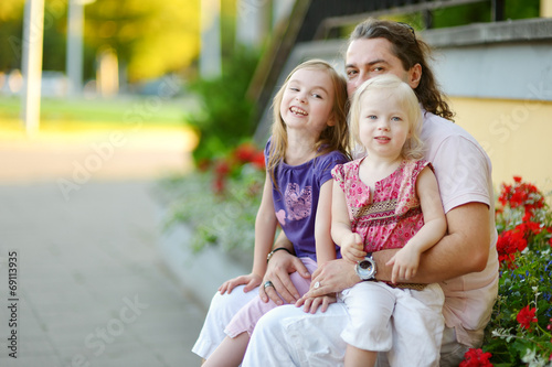 canvas print picture Young father and his daughters