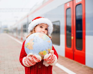 Happy little Santa with a globe
