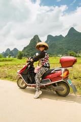 Woman on an elektoro-scooter