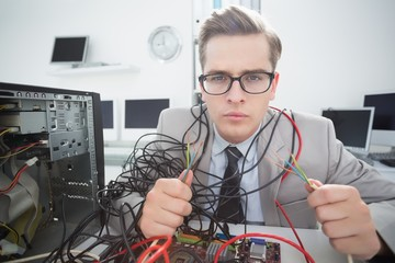 Computer engineer working on broken cables