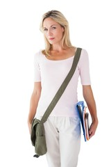 Blonde mature student carrying bag and books