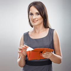 Business woman hold purse , credit card. Gray background