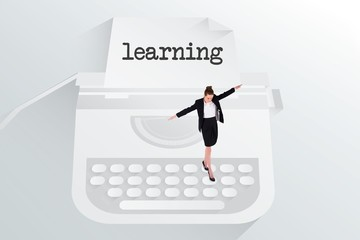 The word learning and businesswoman performing a balancing act
