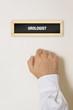 Постер, плакат: Male patient knocking on Urologist door