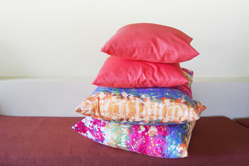 pink and multicolor pillow on sofa