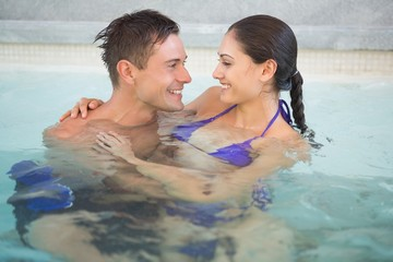 Romantic couple in swimming pool