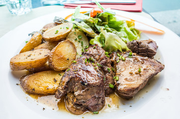 steak beef meat with tomato and potatoes