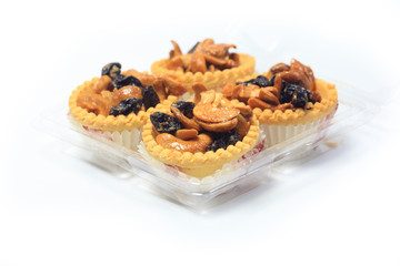 tartlet with dried fruit, on white background