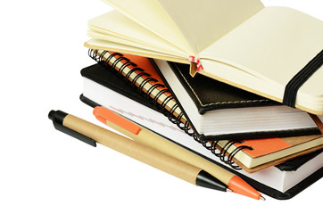 Stack of notebooks and pens