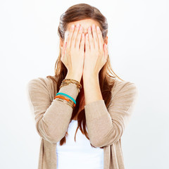 Woman isolated portrait, hides face with hand.
