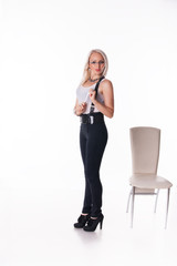 Businesswoman stands near a chair