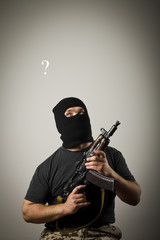 Man with gun and question mark.