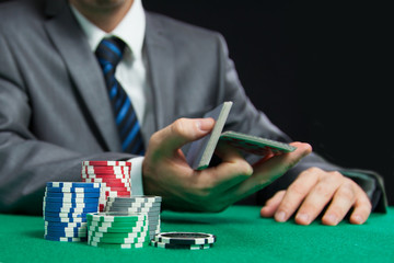 Blackjack Or Poker Game, Casino Worker Shuffling Cards