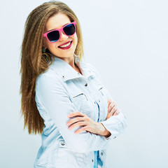 fashionable teenager girl standing against white background