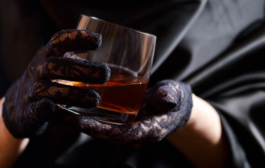 woman in black glass of whiskey