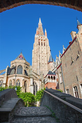 Bruges - Church of Our Lady from east in morning